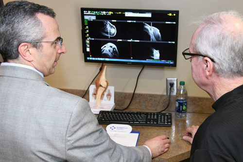 Dr. Cusmariu explaining imaging to patient
